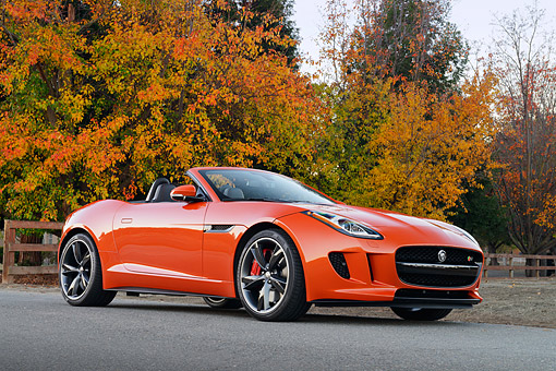 AUT 12 RK0382 01 © Kimball Stock 2014 Jaguar F-Type Orange 3/4 Front View On Pavement By Autumn Trees