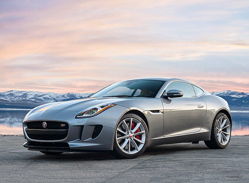 AUT 12 RK0385 01 © Kimball Stock 2015 Jaguar F-Type Silver On Lake By Mountain