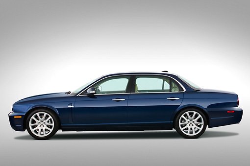 AUT 12 IZ0001 01 © Kimball Stock 2009 Jaguar XJ8L Blue Profile View Studio