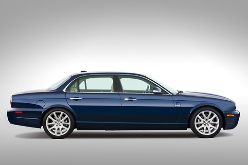 AUT 12 IZ0002 01 © Kimball Stock 2009 Jaguar XJ8L Blue Profile View Studio