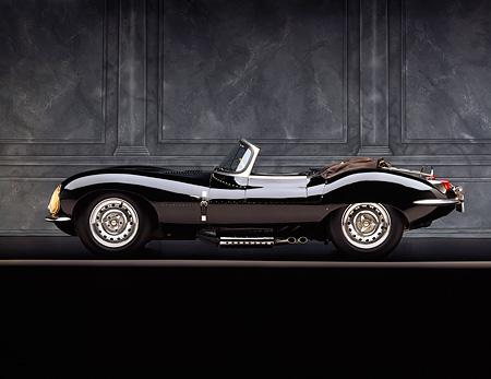 AUT 12 RK0007 06 © Kimball Stock 1957 Jaguar XKSS Convertible Black Profile On Gray Line Gray Marble Background Studio