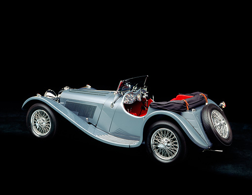 AUT 12 RK0048 01 © Kimball Stock 1938 Jaguar SS-100 Convertible Silver 3/4 Rear View Studio Background