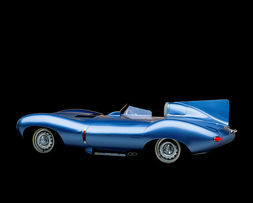 AUT 12 RK0059 05 © Kimball Stock 1955 Jaguar XKD 528 D Type  Roadster Light Blue 3/4 Rear View Studio