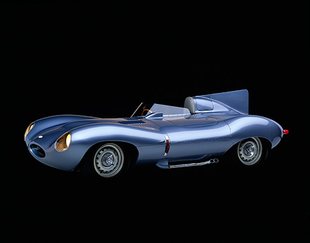 AUT 12 RK0060 06 © Kimball Stock 1955 Jaguar XKD 528 D Type Roadster Light Blue 3/4 Side View Studio