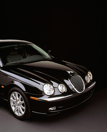 AUT 12 RK0073 04 © Kimball Stock 2000 Jaguar S Type V8 Sport Package Black Close Up Front 3/4 View Studio