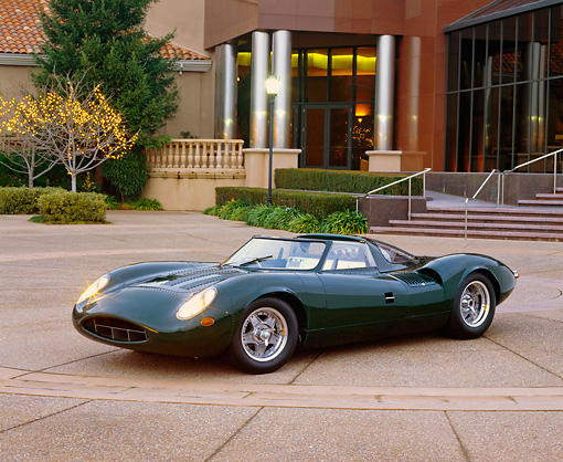 AUT 12 RK0077 02 © Kimball Stock 1966 Jaguar XJ13 Recreation Convertible Green 3/4 Side View In Front Of Museum Headlights On