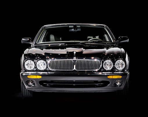 AUT 12 RK0080 04 © Kimball Stock 2000 Jaguar XJ8 Black Low Head On Shot