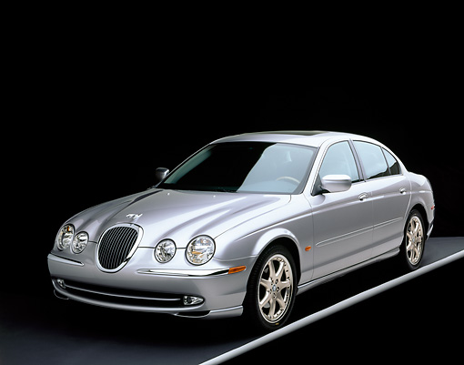 AUT 12 RK0092 05 © Kimball Stock 2001 Jaguar Type S Silver Front 3/4 View On Gray Line Studio