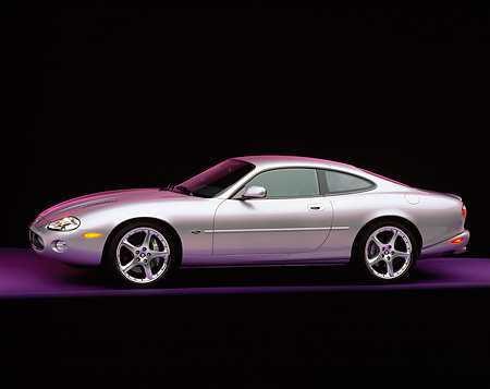 AUT 12 RK0107 01 © Kimball Stock 2001 Jaguar XKR Silverstone Coupe 3/4 Side View On Purple Floor Studio