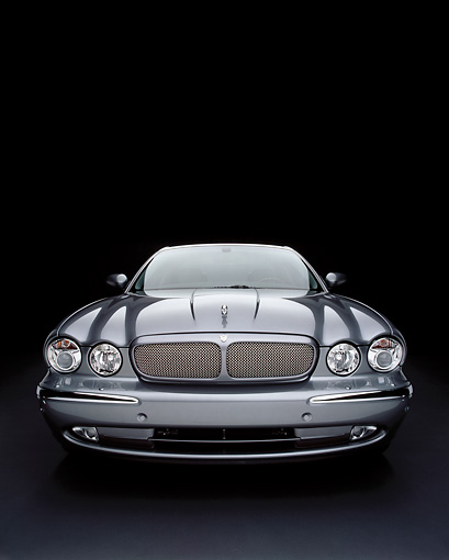 AUT 12 RK0192 06 © Kimball Stock 2004 Jaguar XJR Gray Wide Angle Head On View Studio