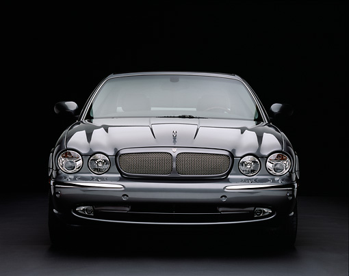 AUT 12 RK0193 10 © Kimball Stock 2004 Jaguar XJR Gray Head On View On Gray Floor Studio