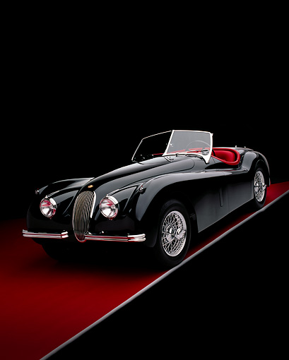 AUT 12 RK0194 07 © Kimball Stock 1954 Jaguar XK120 M Roadster Black 3/4 Front View Studio