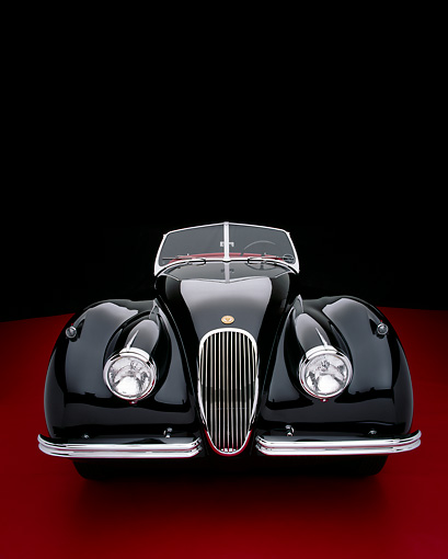 AUT 12 RK0196 04 © Kimball Stock 1954 Jaguar XK120 M Roadster Black Head On View Studio