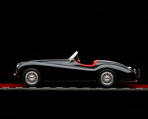 AUT 12 RK0198 03 © Kimball Stock 1954 Jaguar XK120 M Roadster Black Profile Checkered Line Studio