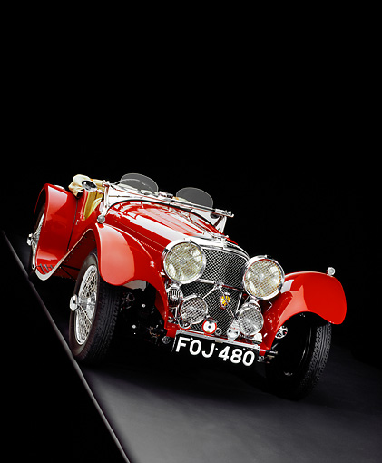 AUT 12 RK0210 09 © Kimball Stock 1939 Jaguar SS100 Convertible Red Slanted 3/4 Front View Studio