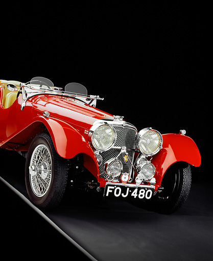 AUT 12 RK0211 05 © Kimball Stock 1939 Jaguar SS100 Convertible Red Slanted 3/4 Front View Studio
