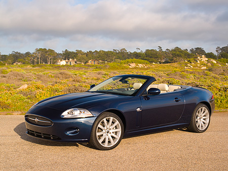 AUT 12 RK0227 01 © Kimball Stock 2007 Jaguar XK Convertible Blue 3/4 Front View On Pavement
