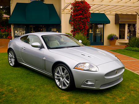AUT 12 RK0251 01 © Kimball Stock 2007 Jaguar XKR Silver 3/4 Front View On Grass By Building