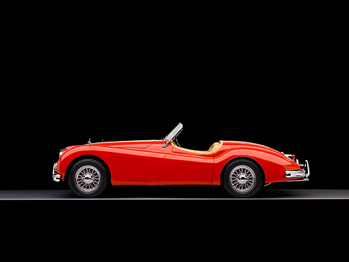 AUT 12 RK0252 02 © Kimball Stock 1957 Jaguar XK140 Convertible Red Profile View Studio