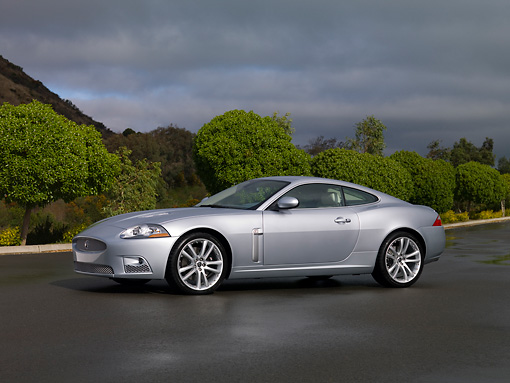 AUT 12 RK0258 01 © Kimball Stock 2007 Jaguar XKR Coupe Silver 3/4 Side View On Pavement