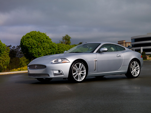 AUT 12 RK0259 01 © Kimball Stock 2007 Jaguar XKR Coupe Silver Low 3/4 Side View On Pavement
