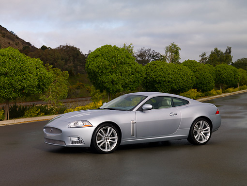 AUT 12 RK0260 01 © Kimball Stock 2007 Jaguar XKR Coupe Silver 3/4 Side View On Pavement