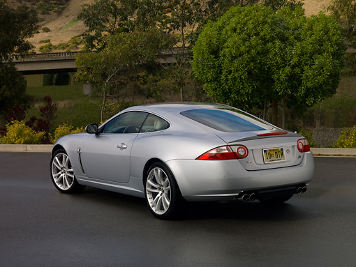 AUT 12 RK0262 01 © Kimball Stock 2007 Jaguar XKR Coupe Silver Low 3/4 Rear View On Pavement