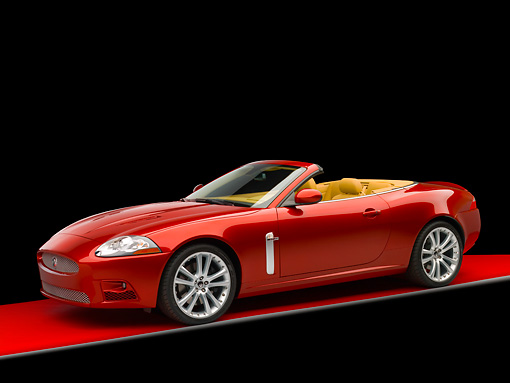 AUT 12 RK0266 01 © Kimball Stock 2007 Jaguar XKR Convertible Red 3/4 Side View On Red Floor Studio