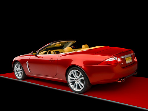 AUT 12 RK0268 02 © Kimball Stock 2007 Jaguar XKR Convertible Red 3/4 Rear View On Red Floor Studio
