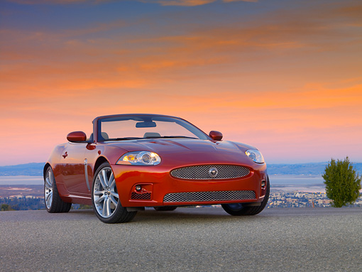 AUT 12 RK0274 01 © Kimball Stock 2007 Jaguar XKR Convertible Red Low 3/4 Front View On Pavement