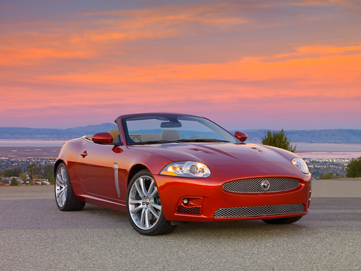 AUT 12 RK0275 01 © Kimball Stock 2007 Jaguar XKR Convertible Red 3/4 Front View On Pavement