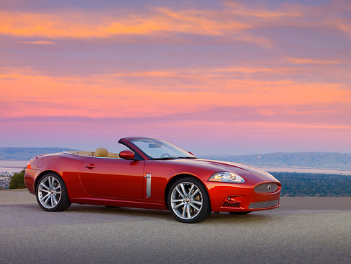 AUT 12 RK0276 01 © Kimball Stock 2007 Jaguar XKR Convertible Red 3/4 Side View On Pavement