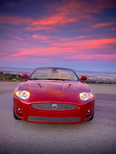 AUT 12 RK0279 01 © Kimball Stock 2007 Jaguar XKR Convertible Red Head On View On Pavement