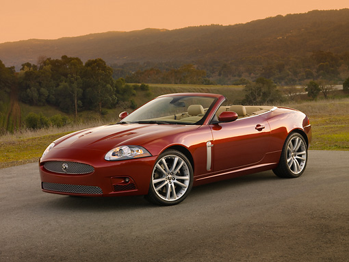 AUT 12 RK0280 01 © Kimball Stock 2007 Jaguar XKR Convertible Red 3/4 Front View On Pavement