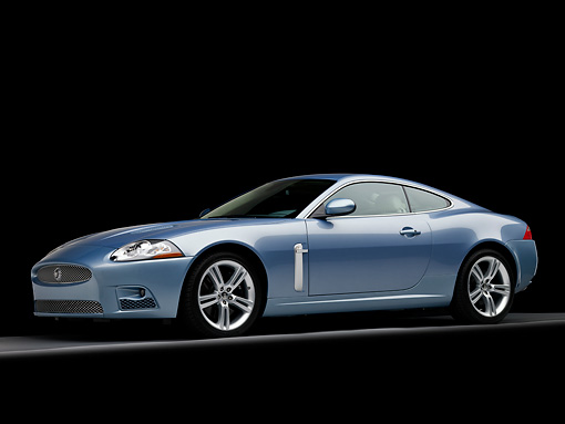 AUT 12 RK0281 01 © Kimball Stock 2008 Jaguar XKR Coupe Blue 3/4 Front View Low Studio