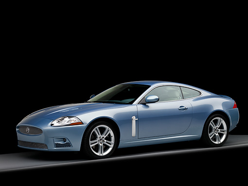 AUT 12 RK0282 01 © Kimball Stock 2008 Jaguar XKR Coupe Blue 3/4 Front View Studio