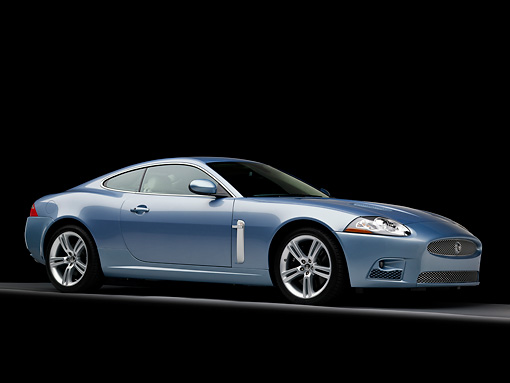 AUT 12 RK0288 01 © Kimball Stock 2008 Jaguar XKR Coupe Blue 3/4 Front View Studio