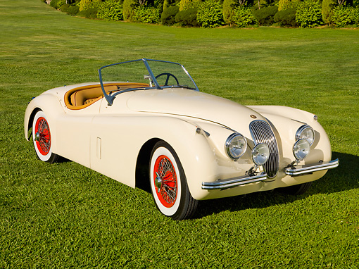 AUT 12 RK0289 01 © Kimball Stock 1954 Jaguar XK120 OTS SE Cream 3/4 Front View On Grass