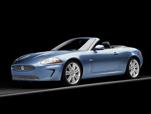 AUT 12 RK0303 01 © Kimball Stock 2010 Jaguar XKR Convertible Blue 3/4 Front View Studio