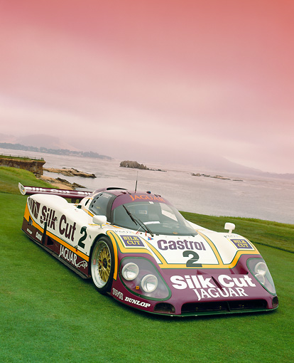 AUT 13 RK0040 11 © Kimball Stock Silk Cut Jaguar XJR-9 Race Car 3/4 Front View On Grass Filtered Le Manns Winner In 1988