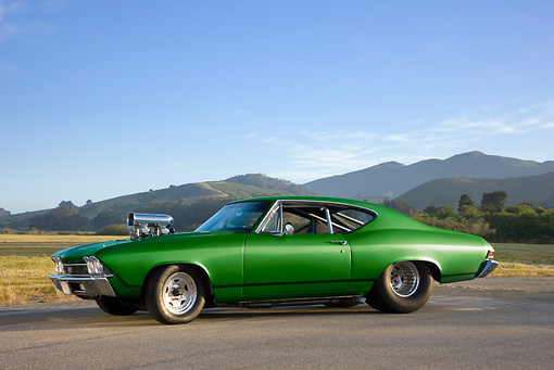 AUT 13 RK0243 01 © Kimball Stock 1968 Chevrolet Chevelle Dragster Green 3/4 Front View By Field Mountains
