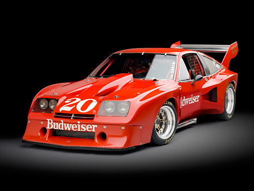 AUT 13 RK0303 01 © Kimball Stock 1976 Devon Monza Race Car Red 3/4 Front View Studio