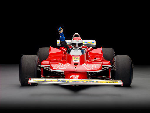 AUT 13 RK0321 01 © Kimball Stock 1979 Ferrari 312 T4 F1 Race Car Red Head On View With Rider Studio