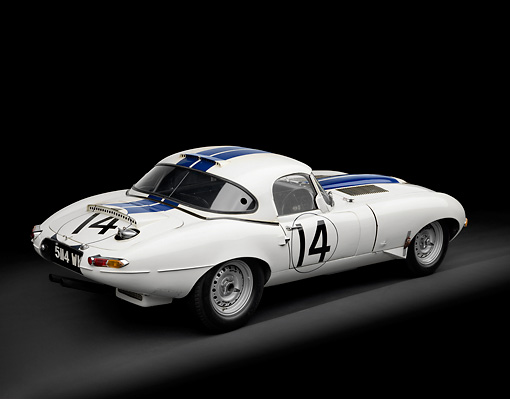 AUT 13 RK0334 01 © Kimball Stock 1963 Jaguar Lightweight E-Type 5114 WK White With Blue Stripes 3/4 Rear View In Studio