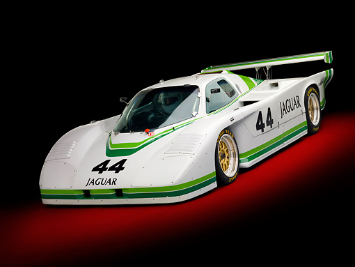 AUT 13 RK0357 01 © Kimball Stock 1984 Jaguar GTP XJR-5 IMSA Race Car White And Green 3/4 Front View In Studio