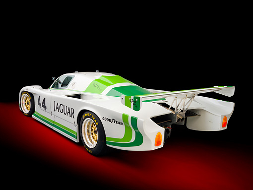 AUT 13 RK0360 01 © Kimball Stock 1984 Jaguar GTP XJR-5 IMSA Race Car White And Green 3/4 Rear View In Studio