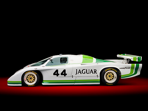 AUT 13 RK0361 01 © Kimball Stock 1984 Jaguar GTP XJR-5 IMSA Race Car White And Green Profile View In Studio