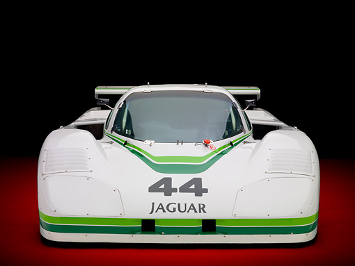 AUT 13 RK0362 01 © Kimball Stock 1984 Jaguar GTP XJR-5 IMSA Race Car White And Green Head On View In Studio
