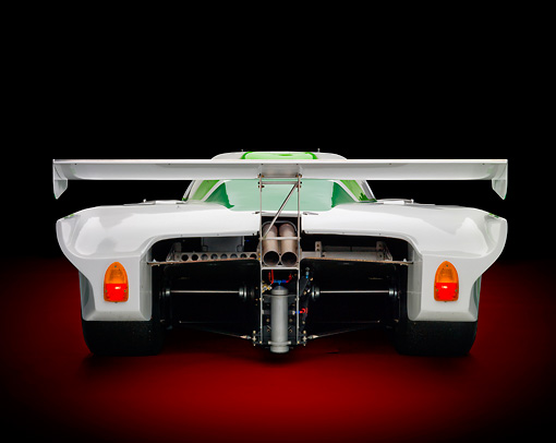 AUT 13 RK0363 01 © Kimball Stock 1984 Jaguar GTP XJR-5 IMSA Race Car White And Green Rear View In Studio