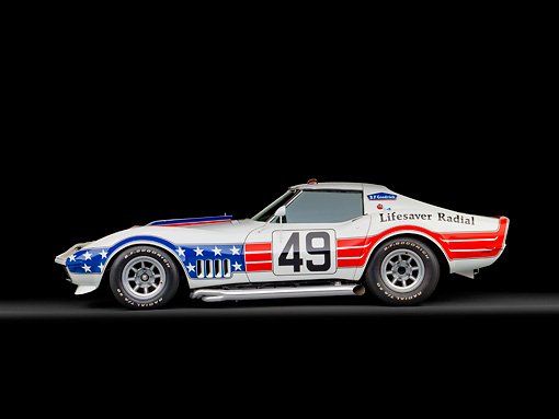AUT 13 RK0372 01 © Kimball Stock 1969 Chevrolet Corvette BFG #49 ZL-1 Race Car Red, White And Blue Profile View In Studio